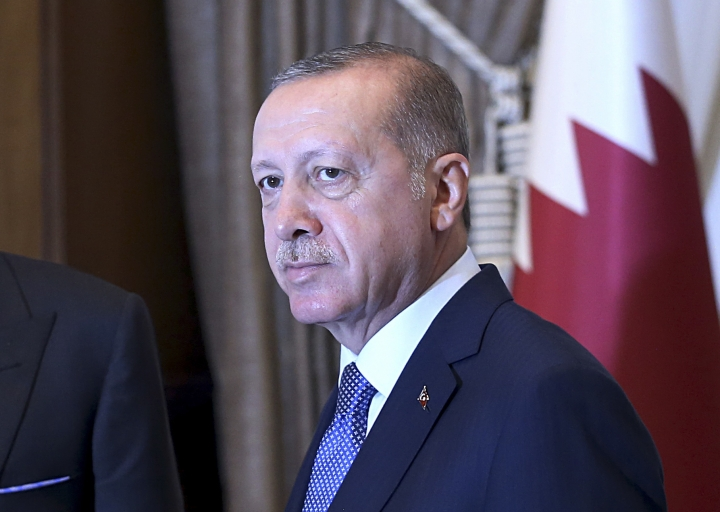 Turkey's President Recep Tayyip Erdogan, as he shakes hands with Qatar's Emir Sheikh Tamim bin Hamad Al Thani prior to their talks at the Presidential Palace in Ankara, Turkey, Wednesday, Aug. 15, 2018. Turkey said Wednesday it is increasing tariffs on some U.S. products like cars, alcohol, and coal _ a move that is unlikely to have much economic impact but highlights the deteriorating relations with the U.S. in a feud that has already helped trigger a currency crisis. (Presidential Press Service via AP, Pool)