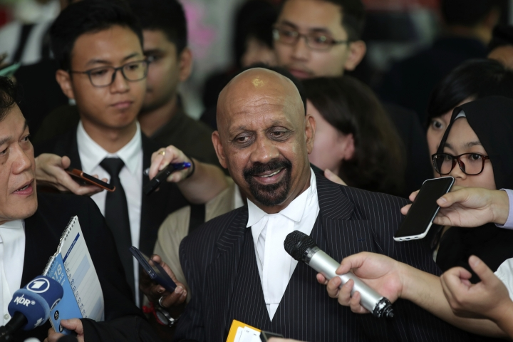 Naran Singh, center, lawyer for Vietnamese Doan Thi Huong, center, speaks during a press conference after a court hearing at Shah Alam High Court in Shah Alam, Malaysia, Thursday, Aug. 16, 2018. Malaysian court has ordered Indonesia's Siti Aisyah and Vietnam's Doan Thi Huong, to enter their defense over the murder of north Korean leader's half brother in a brazen assassination that has gripped the world. (AP Photo/Jeffrey Ong)