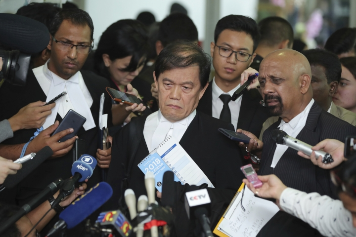 Hisyam Teh Poh Teik, center, and Naran Singh, right, lawyers for Vietnamese Doan Thi Huong speak during a press conference after court hearing at Shah Alam High Court in Shah Alam, Malaysia, Thursday, Aug. 16, 2018. Huong and Indonesia's Siti Aisyah, two Southeast Asian women on trial for the brazen assassination of the North Korean leader's half brother were told to begin their defense Thursday, extending the trial for several more months. (AP Photo/Jeffrey Ong)