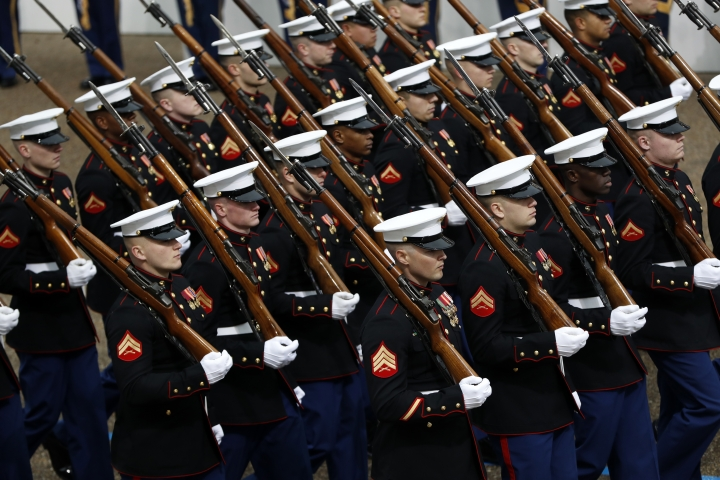 FILE - In this Jan. 20, 2017 file photo, Marines march during the 58th Presidential Inauguration parade for President Donald Trump in Washington. Trump's lofty vision of big tanks and vintage aircraft moving through the streets of Washington in a show of patriotic force crumbled Friday under the weight of logistics, including a $92 million price tag. (AP Photo/Pablo Martinez Monsivais)