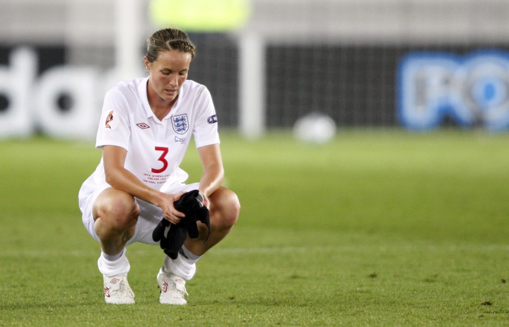 FILE - In this file photo dated Thursday, Sept. 10, 2009, England's Casey Stoney reacts after loosing to team Germany in the final of Women's Euro 2009 soccer match in Helsinki, Finland. After a top flight career as a national team player, Stoney has rebuilt the Man United women's soccer squad and the rebooted team play their first game Sunday Aug. 19, 2018, against Liverpool, with Stoney as coach. (AP Photo/Matthias Schrader, FILE)