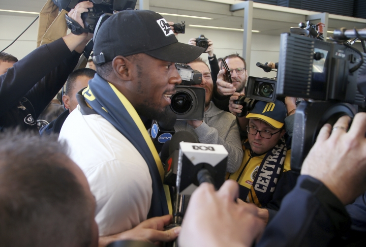 Jamaica's Usain Bolt briefly speaks as he arrives in Sydney, Saturday, Aug. 18, 2018. Olympic gold medalist sprinter, Bolt is hoping to impress the coaching staff enough to earn a contract with the Central Coast Mariners for the 2018-19 season in Australia's top-flight soccer competition.(AP Photo/Rick Rycroft)