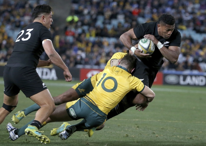 New Zealand's Waisake Naholo, right, is brought down by Australia's Bernard Foley during their rugby union test match in Sydney, Saturday, Aug. 18, 2018. (AP Photo/Rick Rycroft)