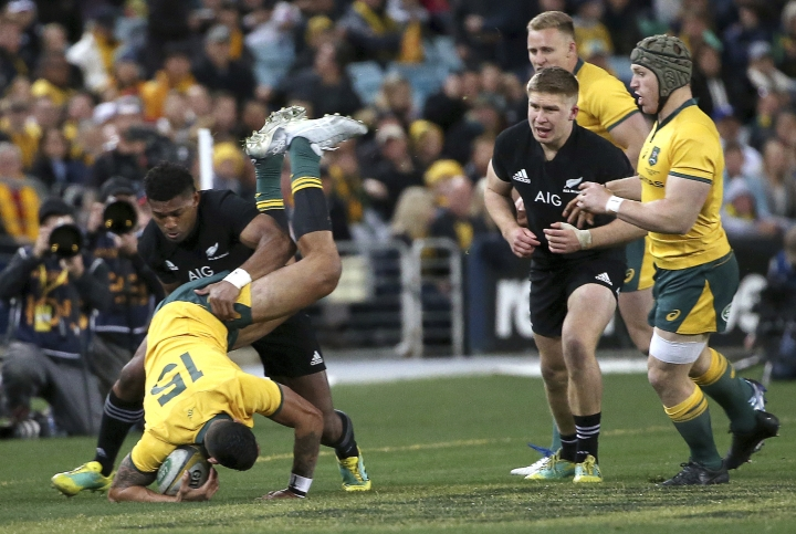 Australia's Israel Folau is dumped by New Zealand's Waisake Naholo during their rugby union test match in Sydney, Saturday, Aug. 18, 2018. (AP Photo/Rick Rycroft)