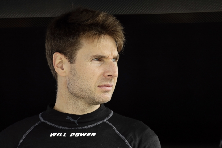 Will Power looks out from his pit box before a practice session for Sunday's IndyCar series auto race, Saturday, Aug. 18, 2018, in Long Pond, Pa. (AP Photo/Matt Slocum)