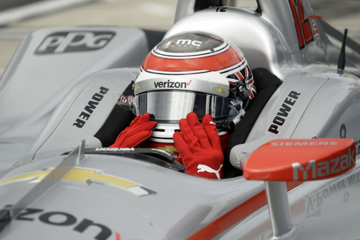 Will Power adjusts his visor before a practice session for Sunday's IndyCar series auto race, Saturday, Aug. 18, 2018, in Long Pond, Pa. (AP Photo/Matt Slocum)