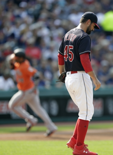 Cleveland Indians starting pitcher Adam Plutko, right, waits for Baltimore Orioles' Jonathan Villar to run the bases after Villar hit a three-run home run in the third inning of a baseball game, Saturday, Aug. 18, 2018, in Cleveland. (AP Photo/Tony Dejak)