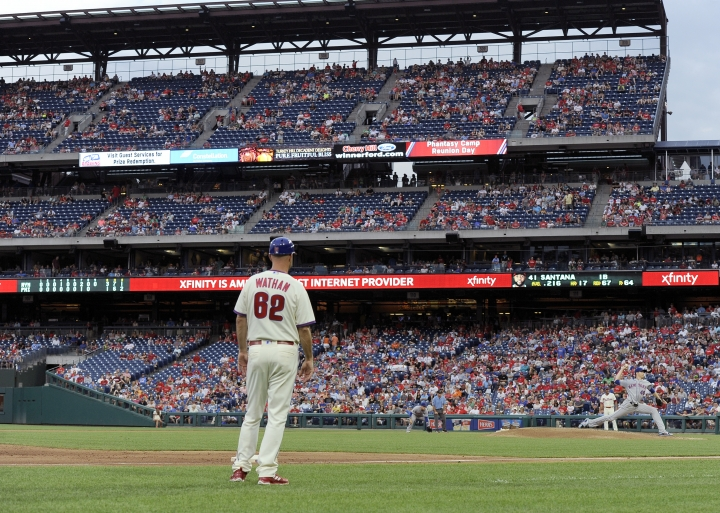 New York Mets' Jacob deGrom, right, throws in the ninth inning of a baseball game as Philadelphia Phillies third base coach Dusty Wathan watches, Saturday, Aug. 18, 2018, in Philadelphia. The Mets won 3-1. (AP Photo/Michael Perez)