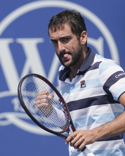 Marin Cilic, of Croatia, reacts during a semifinal match against Novak Djokovic, of Serbia, at the Western & Southern Open tennis tournament, Saturday, Aug. 18, 2018, in Mason, Ohio. (AP Photo/John Minchillo)