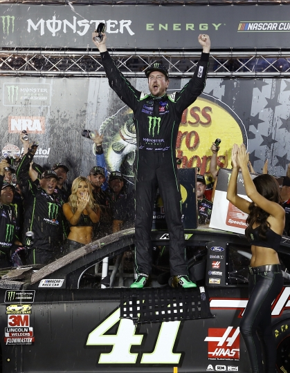 Kurt Busch celebrates after winning the NASCAR Cup Series auto race Saturday, Aug. 18, 2018, in Bristol, Tenn. (AP Photo/Wade Payne)