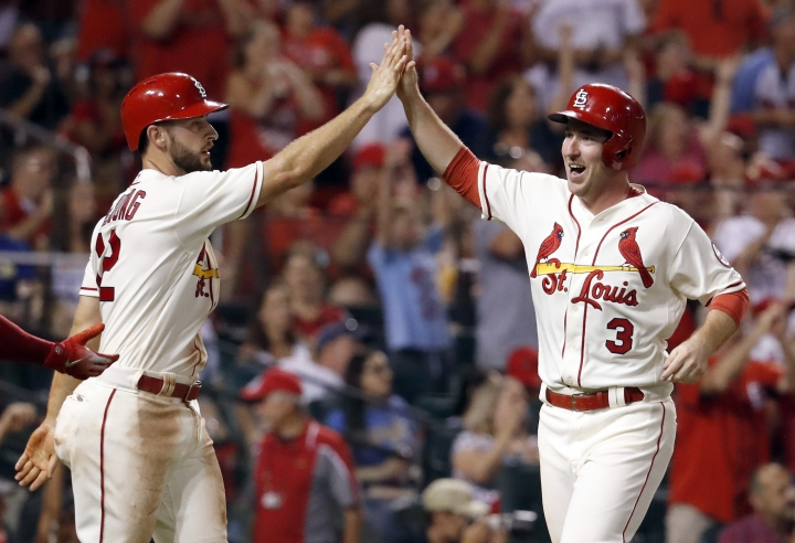 St. Louis Cardinals' Jedd Gyorko (3) and Paul DeJong celebrate after scoring on a two-run triple by Harrison Bader during the sixth inning of a baseball game against the Milwaukee Brewers, Saturday, Aug. 18, 2018, in St. Louis. (AP Photo/Jeff Roberson)
