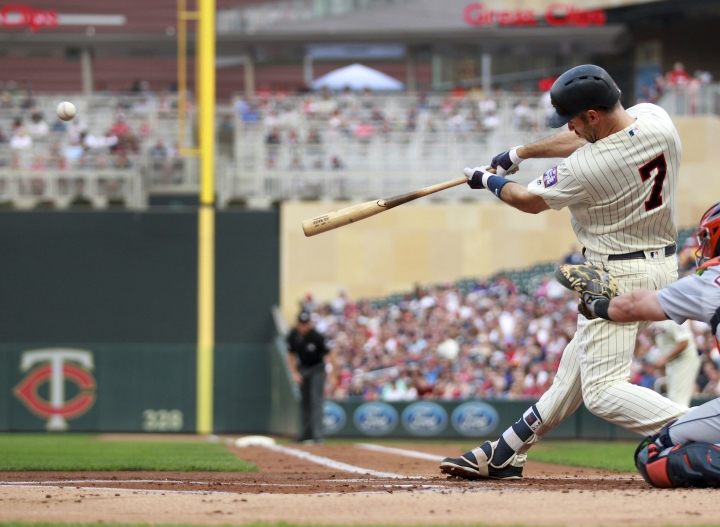 Minnesota Twins' Joe Mauer hits a home run against the Detroit Tigers in the first inning during a baseball game Saturday, Aug. 18, 2018, in Minneapolis. (AP Photo/Andy Clayton-King)