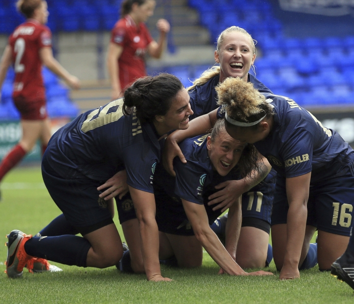 Manchester United Women's Lizzie Arnot, centre down, celebrates after scoring her sides first goal during a domestic cup game at Prenton Park in Liverpool, England, Sunday Aug. 19, 2018. In its first competitive game in 13 years, United's women's side beat Liverpool 1-0 in a domestic cup game that marked a new era on Sunday. (Clint Hughes/PA via AP)
