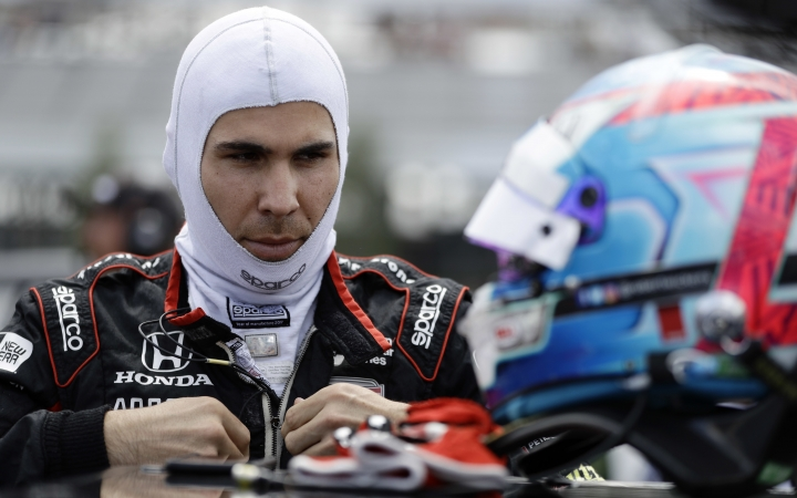 Robert Wickens prepares to qualify for Sunday's IndyCar series auto race, Saturday, Aug. 18, 2018, in Long Pond, Pa. (AP Photo/Matt Slocum)