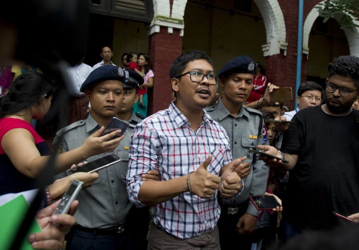 Reuters journalist Wa Lone talks to journalists as they leave the court after their trial Monday, Aug. 20, 2018, in Yangon, Myanmar. The two reporters, Wa Lone and Kyaw Soe Oo are accused of illegally possessing official information. (AP Photo/Thein Zaw)