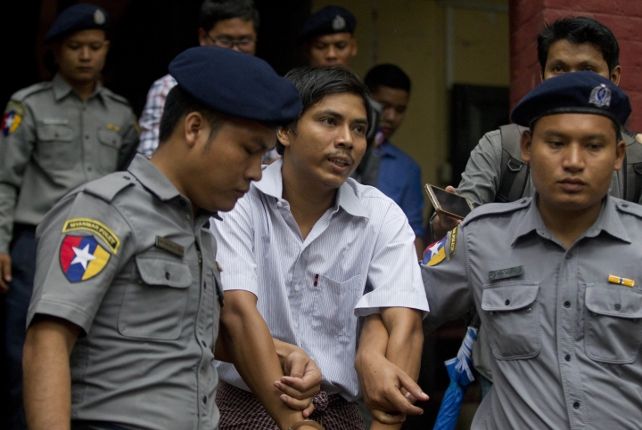 Reuters journalist Kyaw Soe Oo talks to journalists as they leave the court after their trial Monday, Aug. 20, 2018, in Yangon, Myanmar. The two reporters, Wa Lone and Kyaw Soe Oo are accused of illegally possessing official information. (AP Photo/Thein Zaw)