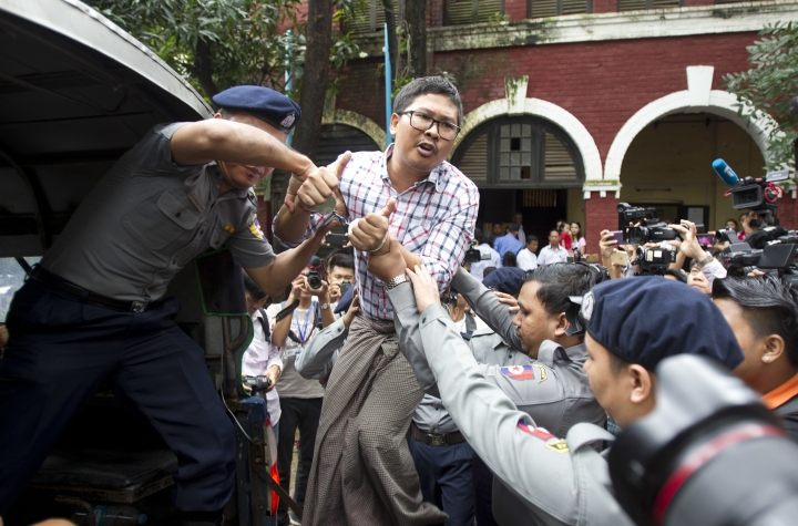 Reuters journalist Wa Lone talks to journalists from police truck as they leave the court after their trial Monday, Aug. 20, 2018, in Yangon, Myanmar. The two reporters, Wa Lone and Kyaw Soe Oo are accused of illegally possessing official information. (AP Photo/Thein Zaw)