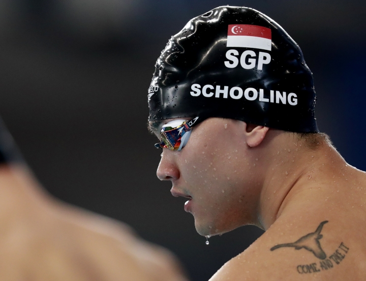 Singapore's Joseph Schooling waits to start in his heat in the men's 50m freestyle during the swimming competition at the 18th Asian Games in Jakarta, Indonesia, Tuesday, Aug. 21, 2018. (AP Photo/Bernat Armangue)