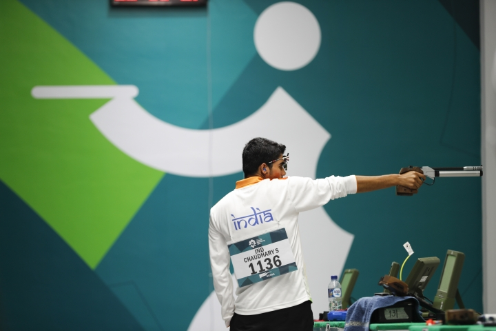 India's Saurabh Chaudhary shoots in the final round of the 10m air pistol men's final shooting event during the 18th Asian Games in Palembang, Indonesia, Tuesday, Aug. 21, 2018. (AP Photo/Vincent Thian)