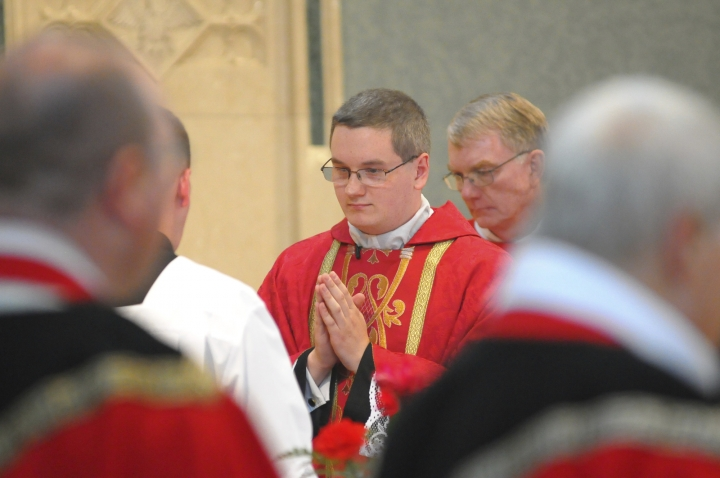 File- This June 8, 2014, file photo shows the Reverend Kevin M. Lonergan, center, who was ordained celebrated his first mass at St. Patrick's Church in Pottsville, Pa. The 30-year-old Lonergan was charged Tuesday, Aug. 21, 2018, with corruption of minors, a felony, and indecent assault. He is facing charges in connection with a 17-year-old girl he met at Mass, including allegations that he sent her nude images of himself on social media and groped her during a hug. (Andy Matsko/The Republican-Herald via AP)