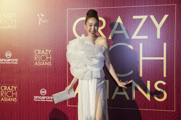 """Actress Constance Lau poses for photographers as she arrives for the red carpet screening of the movie """"Crazy Rich Asians"""" on Tuesday, Aug. 21, 2018, in Singapore. (AP Photo/Don Wong)"""
