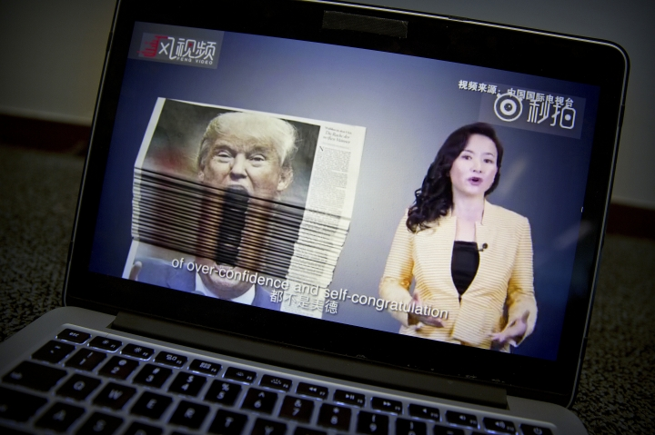 An online video about U.S.-China trade tensions produced by China's state television broadcaster plays on a computer screen in Beijing, China, Thursday, Aug. 23, 2018. The United States and China imposed more tariff hikes on billions of dollars of each other's automobiles, factory machinery and other goods Thursday. Ahead of trade talks in Washington, Chinese state TV mocked President Donald Trump with a sarcastic video posted on the YouTube and other social media pages of its international arm, China Global Television Network. (AP Photo/Mark Schiefelbein)