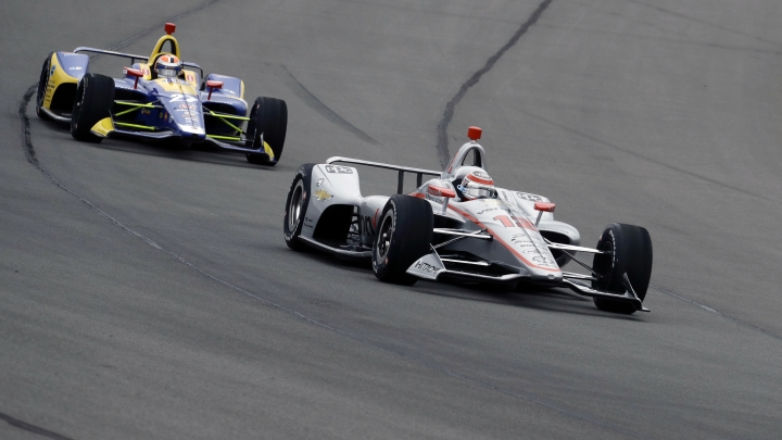 Will Power (12) leads Alexander Rossi (27) into Turn 1 during the IndyCar auto race at Pocono Raceway, Sunday, Aug. 19, 2018, in Long Pond, Pa. (AP Photo/Matt Slocum)