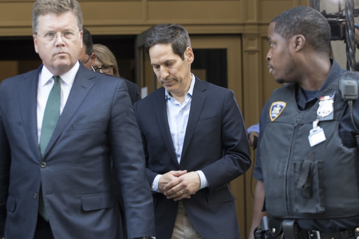 Thomas Frieden, center, leaves Brooklyn federal court, Friday, Aug. 24, 2018, in New York. Frieden, the former director of the U.S. Centers for Disease Control and Prevention has been arrested in New York on a sex abuse charge. (AP Photo/Mary Altaffer)