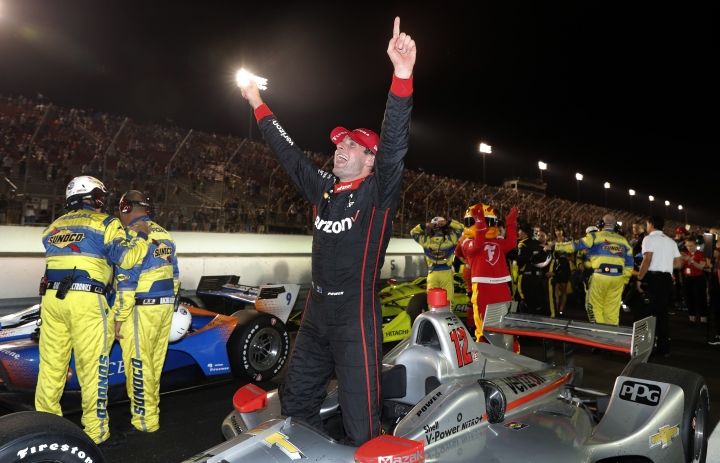 Will Power, of Australia, celebrates after winning the IndyCar auto race at Gateway Motorsports Park on Saturday, Aug. 25, 2018, in Madison, Ill. (AP Photo/Jeff Roberson)