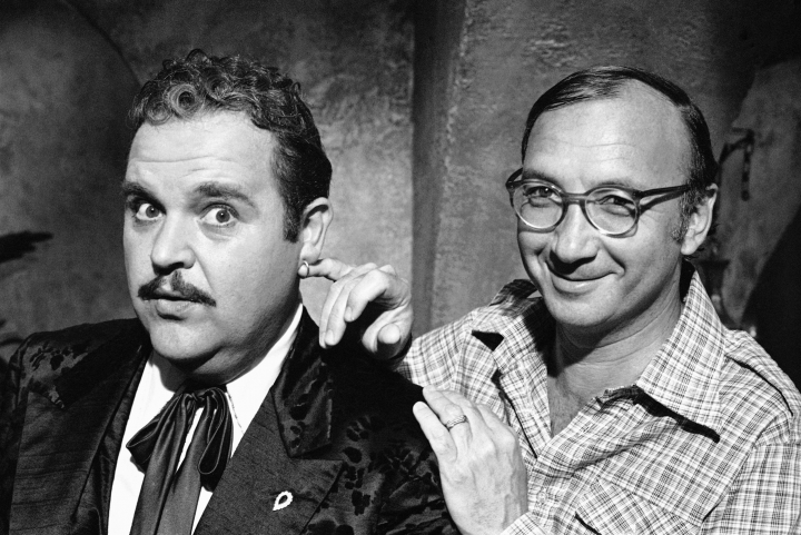 "FILE- In this July 2, 1977, file photo, playwright Neil Simon, right, poses for a photo on the set of ""The Cheap Detective"" with Dom DeLuise. Simon, a master of comedy whose laugh-filled hits such as ""The Odd Couple,"" ""Barefoot in the Park"" and his ""Brighton Beach"" trilogy dominated Broadway for decades, died on Sunday, Aug. 26, 2018. He was 91. (AP Photo, File)"