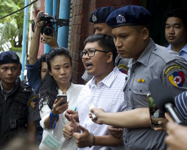Reuters journalist Wa Lone, center, speaks as he leaves a court Monday, Aug. 27, 2018, in Yangon, Myanmar. The Myanmar court delayed the verdict against two Reuters journalists, Wa Lone and Kyaw Soe Oo, on the charge of possessing official documents illegally in a case that has drawn attention to the faltering state of press freedom in the troubled Southeast Asian nation. The verdict that was to be delivered Monday was postponed to Sept. 3. (AP Photo/Thein Zaw)