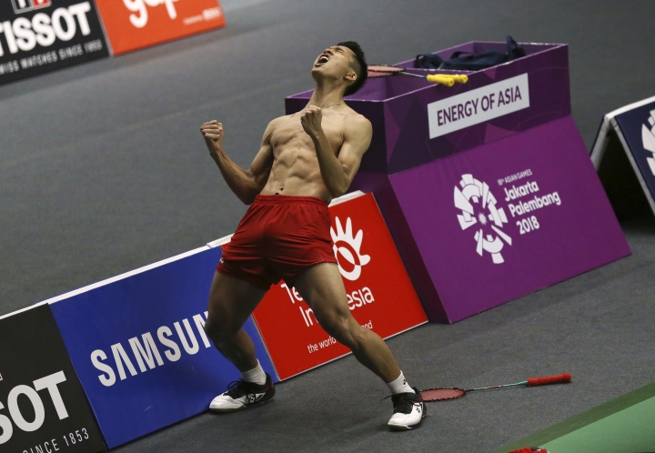 Jonatan Christie of Indonesia celebrates after defeating Kenta Nishimoto of Japan during their men's badminton singles semifinal match at the 18th Asian Games in Jakarta, Indonesia, Monday, Aug. 27, 2018. (AP Photo/Achmad Ibrahim)