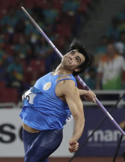 India's Neeraj Chopra throws in the men's javelin final during the athletics competition at the 18th Asian Games in Jakarta, Indonesia, Monday, Aug. 27, 2018. (AP Photo/Lee Jin-man)
