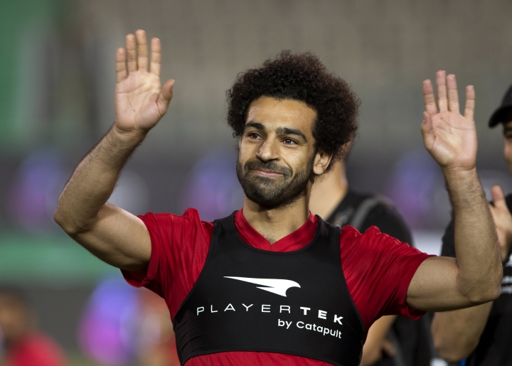 FILE - In this June 9, 2018, file photo, Egyptian national team soccer player and Liverpool's star striker Mohamed Salah smiles as he greets fans during the final training of the national team at Cairo Stadium in Cairo, Egypt. Salah has revived a months-long dispute with soccer authorities in his native Egypt, accusing them of ignoring his complaints about their unauthorized use of his image. (AP Photo/Amr Nabil, File)