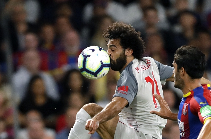 FILE - In this Aug. 20, 2018, file photo, Liverpool's Mohamed Salah, left, duels for the ball with Crystal Palace's James Tomkins during the English Premier League soccer match between Crystal Palace and Liverpool at Selhurst Park stadium in London. Salah has revived a months-long dispute with soccer authorities in his native Egypt, accusing them of ignoring his complaints about their unauthorized use of his image. (AP Photo/Kirsty Wigglesworth, File)