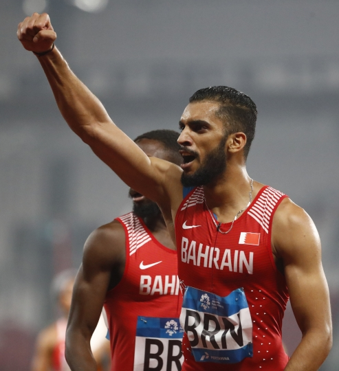 Bahrain's Ali Khamis, celebrates with teammate Abbas Abbas left, after winning the 4x400m mixed relay final during the athletics competition at the 18th Asian Games in Jakarta, Indonesia, Tuesday, Aug. 28, 2018. (AP Photo/Bernat Armangue)