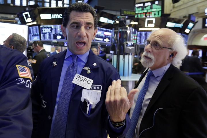 Specialist Peter Mazza, left, and trader Peter Tuchman work on the floor of the New York Stock Exchange, Tuesday, Aug. 28, 2018. Stocks are opening broadly higher on Wall Street as stocks add to the records they've set in the last few days. (AP Photo/Richard Drew)
