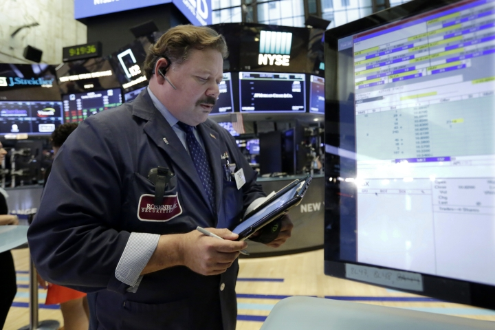 Trader John Santiago works on the floor of the New York Stock Exchange, Tuesday, Aug. 28, 2018. Stocks are opening broadly higher on Wall Street as stocks add to the records they've set in the last few days. (AP Photo/Richard Drew)