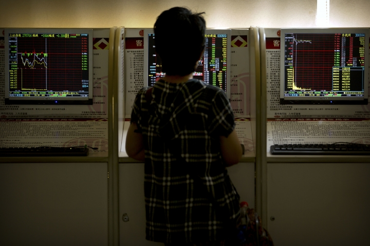 A Chinese investor uses a computer terminal as she monitors stock prices at a brokerage house in Beijing, Wednesday, Aug. 29, 2018. Asian stock markets edged higher Wednesday after Wall Street gained on strength in technology and retailing shares. (AP Photo/Mark Schiefelbein)