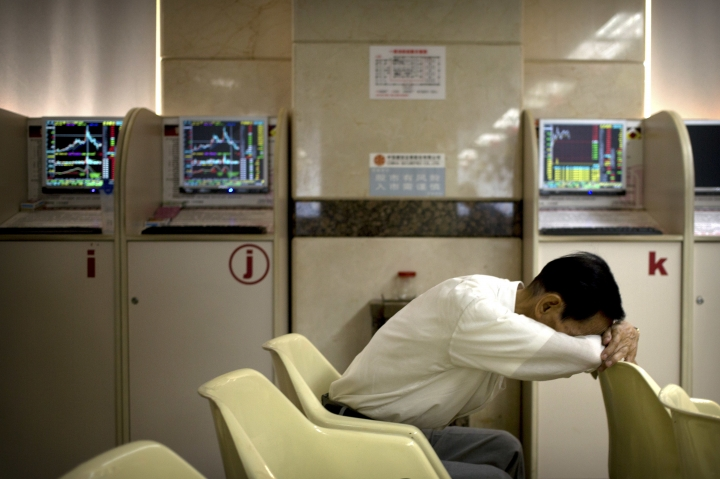 A Chinese investor rests at a brokerage house in Beijing, Wednesday, Aug. 29, 2018. Asian stock markets edged higher Wednesday after Wall Street gained on strength in technology and retailing shares. (AP Photo/Mark Schiefelbein)