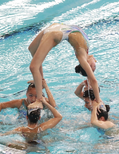 Team Hong Kong performs during the synchronized swimming competition at the 18th Asian Games at Gelora Bung Karno Aquatics Center in Jakarta, Indonesia, Wednesday, Aug. 29, 2018. (AP Photo/Dita Alangkara)
