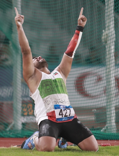 Iran's Ehasan Hadadi celebrates after winning the men's discus final during the athletics competition at the 18th Asian Games in Jakarta, Indonesia, Wednesday, Aug. 29, 2018. (AP Photo/Dita Alangkara)