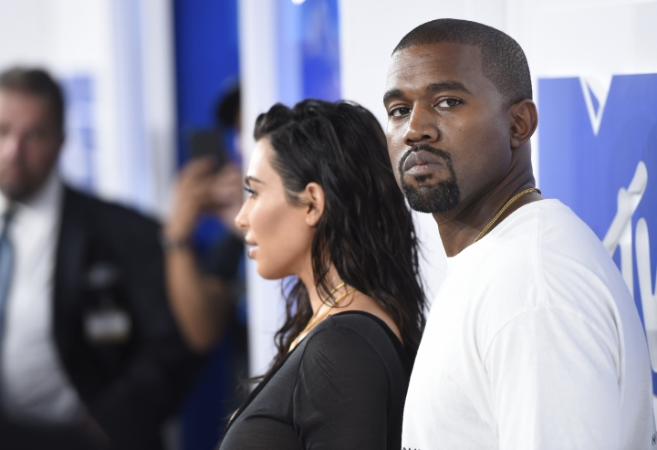"FILE - In this Aug. 28, 2016 file photo, Kim Kardashian West, left, and Kanye West arrive at the MTV Video Music Awards in New York. Kanye West has apologized on a Chicago radio station for suggesting slavery was a ""choice."" (Photo by Evan Agostini/Invision/AP, File)"
