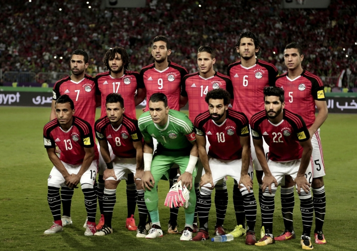 FILE - In this Sunday, Oct. 8, 2017, file photo, Egypt's national football team pose for a photograph ahead of the 2018 World Cup group E qualifying soccer match between Egypt and Congo at the Borg El Arab Stadium in Alexandria, Egypt. Emboldened by his global star power, Mohamed Salah has said out loud what many of his Egyptian teammates have been saying in private for weeks: Failure by the national federation to enforce discipline and stop meddling by sponsors was mostly to blame for the Pharaohs' miserable World Cup run in Russia. (AP Photo/Nariman El-Mofty, File)