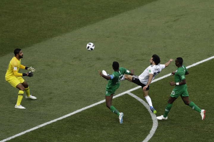 FILE - In this June 25, 2018, file photo, Mohamed Salah scores the opening goal during the group A match between Saudi Arabia and Egypt at the 2018 soccer World Cup at the Volgograd Arena in Volgograd, Russia. Emboldened by his global star power, Salah has said out loud what many of his Egyptian teammates have been saying in private for weeks: Failure by the national federation to enforce discipline and stop meddling by sponsors was mostly to blame for the Pharaohs' miserable World Cup run in Russia. (AP Photo/Themba Hadebe)