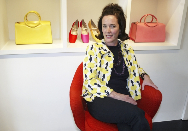 FILE - In this May 13, 2004, file photo, designer Kate Spade sits during an interview in New York. Kate Spade New York will honor its namesake with a tribute, three months after she killed herself. The company Spade sold off years ago will introduce a new designer, Nicola Glass. (AP Photo/Bebeto Matthews, File)