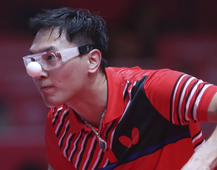 Lkhagvasuren Enkhbat of Mongolia keeps his eye on the ball against Choe Il of North Korea during their men's single table tennis match at the 18th Asian Games in Jakarta, Indonesia, Thursday, Aug. 30, 2018. (AP Photo/Achmad Ibrahim)
