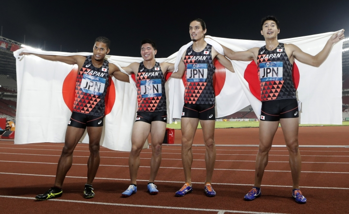 Japan's men's 4x400m relay team celebrate after their third place finish during the athletics competition at the 18th Asian Games in Jakarta, Indonesia, Thursday, Aug. 30, 2018. (AP Photo/Lee Jin-man)