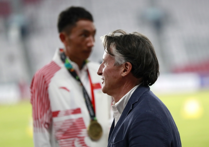 In this Saturday Aug. 25, 2018 photo, President of the International Association of Athletics Federations (IAAF) Sebastian Coe waits at the medal ceremony for the men's marathon during the athletics competition at the 18th Asian Games in Jakarta, Indonesia. Coe says China and Japan are the two most improved countries in athletics over the last six or seven years.(AP Photo/Bernat Armangue)