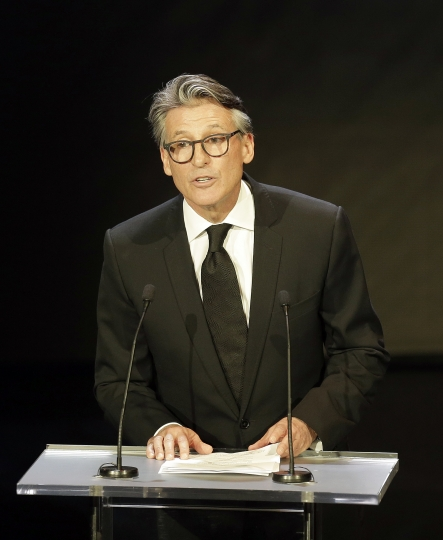 FILE - In this Nov. 24, 2017 file photo, President of the International Association of Athletics Federations (IAAF) Sebastian Coe, delivers a speech, during the 2017 World Athletics Gala Award, in Monaco.Coe says China and Japan are the two most improved countries in athletics over the last six or seven years.(AP Photo/Bernat Armangue)(AP Photo/Claude Paris,File)